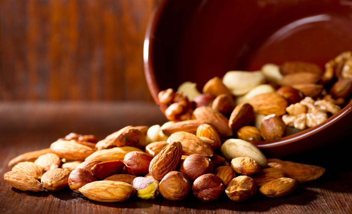Mix nuts on a wooden table | What To Eat When Pregnant