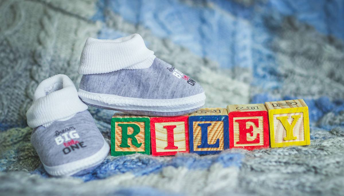 White and gray baby shoes with riley name toy blocks | Best Unisex Baby Names