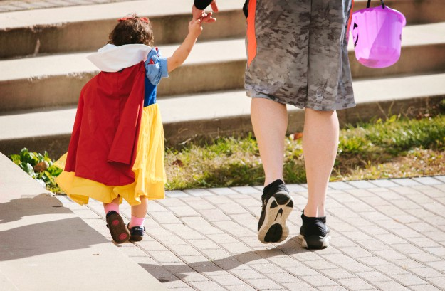 a mother walking with her daughter in a snow white costume | Halloween Safety Tips For Kids | halloween tips