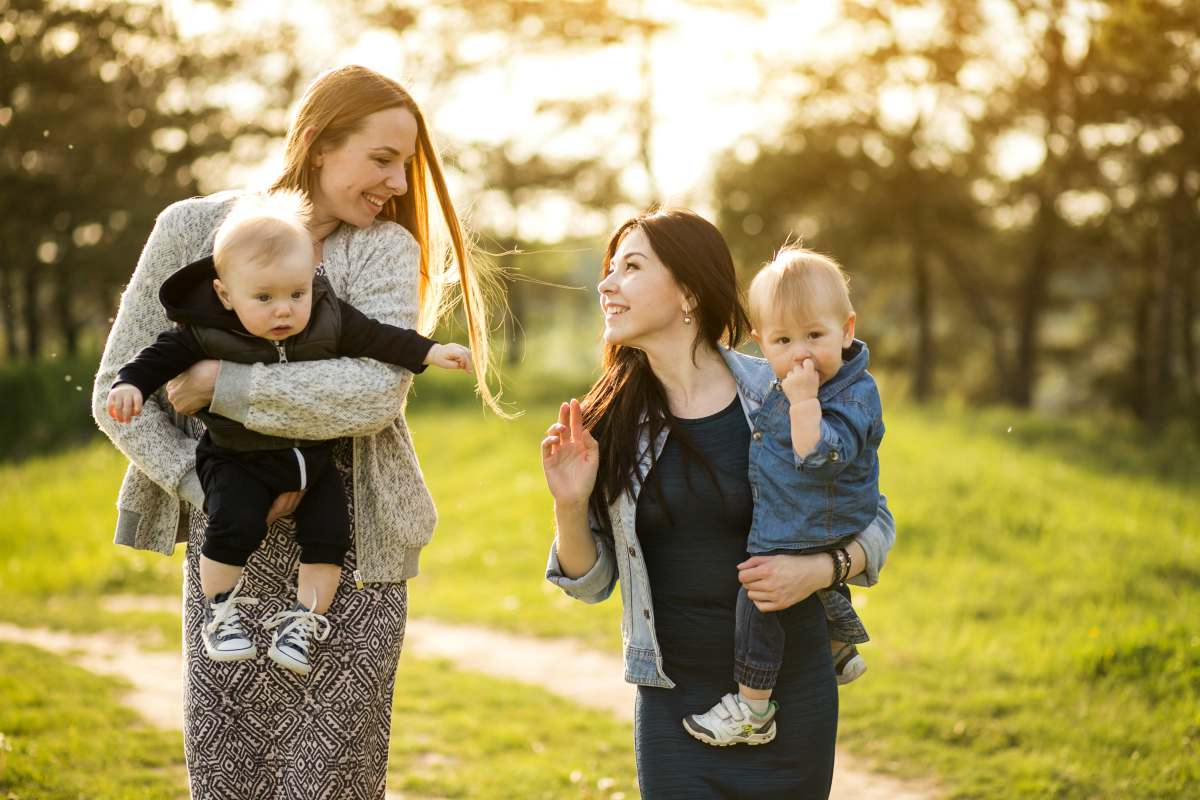 Two mother talking to each other with their sons | How To Win At Single Parenting