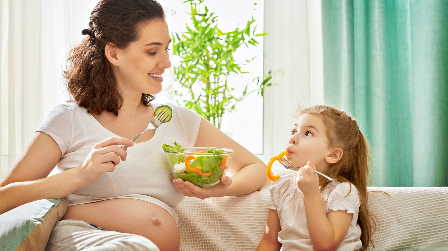 Feature | Pregnant mom holding a bowl of vegetables with her daughter | A Healthy and Balanced Diet For You and Your Baby During Pregnancy